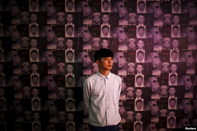 Artist Jirawut Ueasungkomsate poses for a photograph during his exhibition at a gallery in Bangkok, Thailand, March 4, 2016.