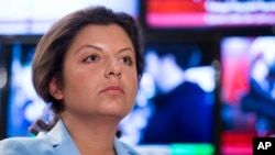 Margarita Simonyan, the head of the Russian television channel RT, listens to a question during her interview with the Associated Press in Moscow, Russia, , Jan. 19, 2018. Simonyan, the head of Russian television channel RT, which U.S. intelligence agencies allege took part in the campaign to influence last year's presidential election, says that having to register as a foreign agent in the United States is already hurting the Kremlin-funded outlet.
