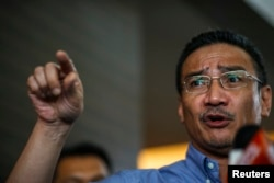 FILE - Malaysia's defense minister Hishammuddin Hussein gestures as he speaks.