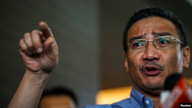 Malaysia's acting Transport Minister Hishammuddin Hussein gestures as he speaks about the search for missing Malaysia Airlines Flight MH370, The Everly Hotel, Putrajaya, March 29, 2014.