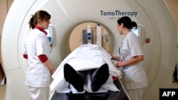 Patient preparing to undergo a tomotherapy rays treatment, at the Oscar Lambret Center in Lille, northern France. (File Photo)