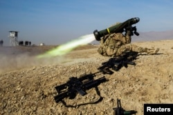 FILE - A U.S. soldier from Dragon Troop of the 3rd Cavalry Regiment fires a Javelin missile system during their first training exercise of the new year near operating base Gamberi in the Laghman province of Afghanistan Jan. 1, 2015.