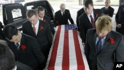 Pallbearers carry the casket of John Granville, the American diplomat killed in Sudan, at his funeral at St. John Vianney R.C. Church in Orchard Park, N.Y., Wednesday, Jan. 9, 2008. Granville, who was from Buffalo, was being driven home around 4 a.m. New