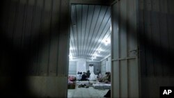 Muslim pilgrims sit inside their accommodation after their arrival at Arafat during the first day of the annual hajj pilgrimage, near the holy city of Mecca, Saudi Arabia, Sept. 10, 2016.