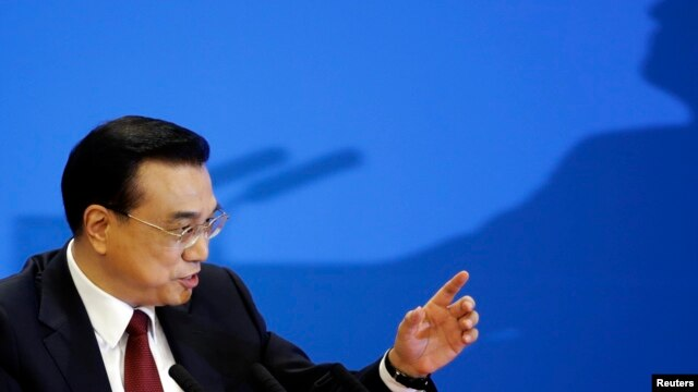 China's Premier Li Keqiang gestures at the end of a news conference following the closing ceremony of China's National People's Congress (NPC) at the Great Hall of the People in Beijing, China, March 16, 2016.