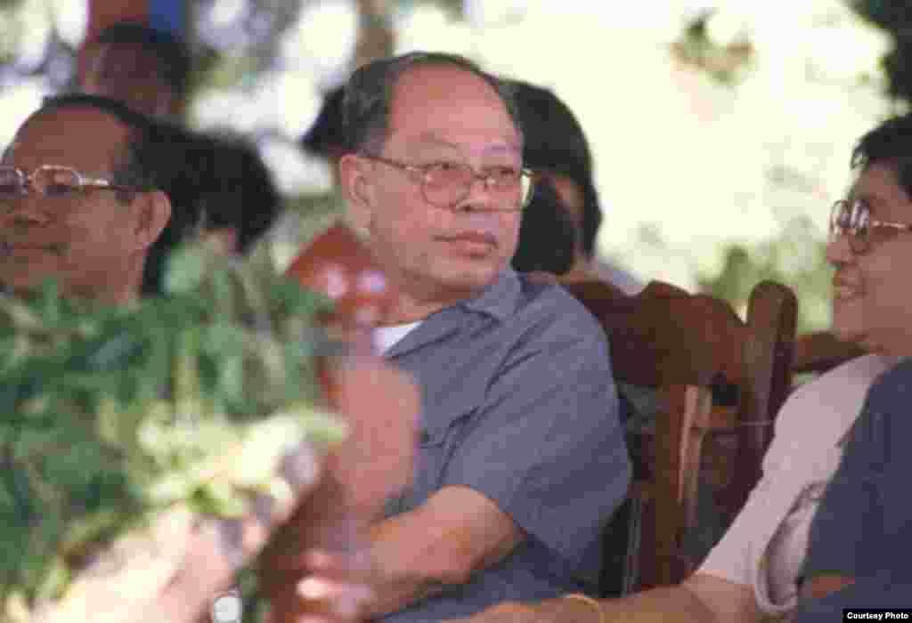 Ieng Sary sits next to his wife during his defection ceremony, Pailin, Cambodia, November, 1996. (Youk Chhang/Documentation Center of Cambodia Archive)