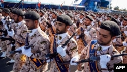 FILE - Members of Iran's Revolutionary Guards Corps (IRGC) march during the annual military parade marking the anniversary of the outbreak of the devastating 1980-1988 war with Saddam Hussein's Iraq, in the capital Tehran, Sept. 22, 2018. More than a dozen Iranian security forces were kidnapped in a pre-dawn raid in southeastern Sistan-Baluchistan province.