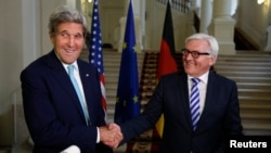 Državni sekretar Džon Keri i nemački minista inostranih poslova Frank Valter Štajnmajer, Beč, 13. juli, 2014.