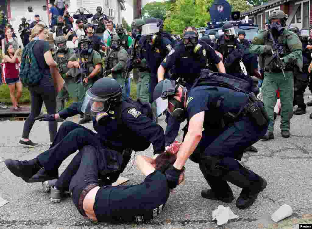 A demonstrator is detained by police during protests in Baton Rouge, Louisiana, USA.
