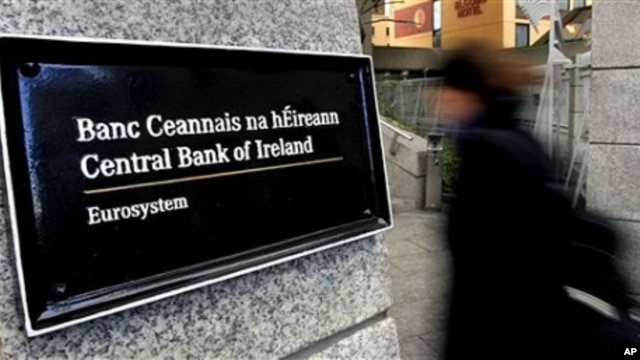 Woman enters offices of Central Bank in Dublin, Ireland.