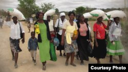 FILE: People take advantage of a maize distribution program in Zimbabwe. (Credit: World Food Program)