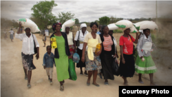 FILE: Residents take advantage of a maize distribution program in Zimbabwe. (Credit: World Food Program)