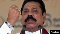 Sri Lanka's former president Mahinda Rajapaksa, who is contesting in the upcoming general election, speaks during the launch ceremony of his manifesto, in Colombo, July 28, 2015.