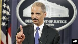 Attorney General Eric Holder answers a question about WikiLeaks during a news conference at the Justice Department in Washington, 29 Nov 2010