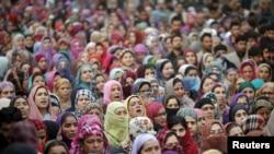 Kashmiri women attend the funeral of Sajad Ahmad Bhat, a suspected Lashkar-e-Taiba militant, on the outskirts of Srinagar, India, Jan. 12, 2016.