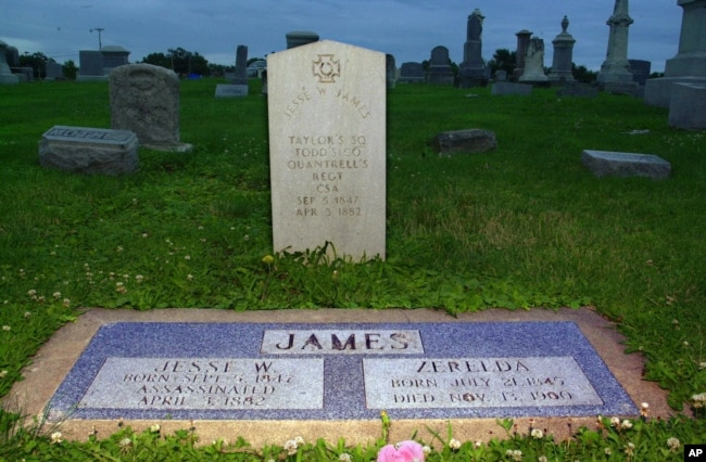 The gravesite of infamous Wild West outlaw Jesse James and his wife, Zerelda, the first cousin he married after a 9-year courtship, at a cemetery in Kearney, Missouri.