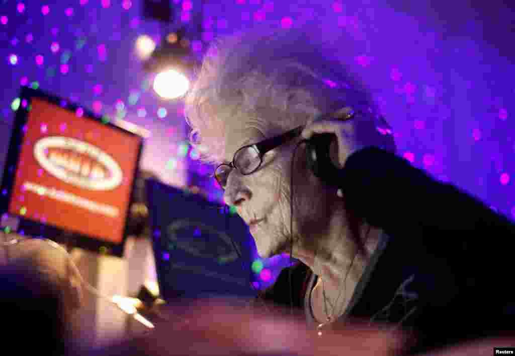 DJ Wika Szmyt, 73, plays music at a club in Warsaw January 4, 2012. (Reuters)