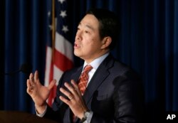 U.S. Attorney Joon Kim speaks to reporters during a news conference in New York, Dec. 12, 2017.