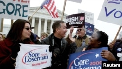 FILE - Supporters of Democrat U.S. Vice President Al Gore (R) and Republican Texas Governor George W. Bush face off against one another in front of the U. S. Supreme Court before Gore's attorney David Boies and Bush attorney Barry Richard entered the cour