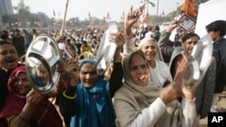 Supporters of India's main opposition National Democratic Alliance protest in the capital, New Delhi, Dec. 22, 2010.