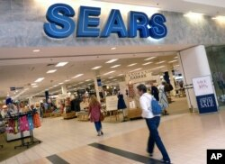 FILE - Shoppers walk into Sears in Peabody, Massachusetts, May 17, 2012.