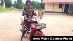 Riding in on her motorbike, Christine Ngbaazande is inspiring girls and women in her South Sudan community to stand up for their rights.