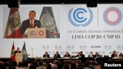 Peru's President Ollanta Humala delivers a speech during the U.N. climate change talks in Lima, Dec. 11, 2014.