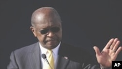 "Republican presidential candidate Herman Cain announces he is suspending his campaign as his wife Gloria, left, looks on Saturday, Dec. 3, 2011, in Atlanta. ""I am suspending my presidential campaign because of the continued distractions and the continued"