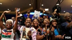 Participants cheer at Presidential Summit