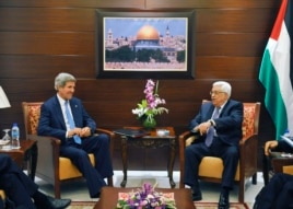 U.S. Secretary of State John Kerry (L) meets with Palestinian President Mahmoud Abbas in the West Bank city of Ramallah July 19, 2013.