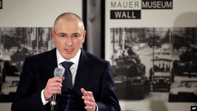 Mikhail Khodorkovsky speaks during his first news conference after his release in Berlin, Sunday, Dec. 22, 2013.