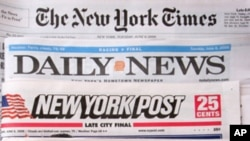 The premiere U.S. edition of The Times of London, bottom, is photographed with Tuesday editions of The New York Times, Daily News, and New York Post June 6, 2006 in New York. Rupert Murdoch's newspaper launched the U.S. edition as part of a push to make t