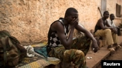 FILE - A man reacts in the RDOT camp in Kilometre 11 (PK11), where some of the last remaining ex-Seleka fighters are sheltering, guarded by African Union and French peacekeeping forces in the capital Bangui, March 14, 2014.