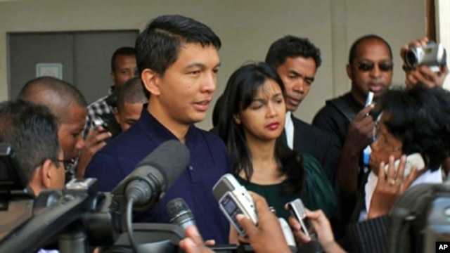 Madagascar's leader Andry Rajoelina speaks to the press after casting his vote at a local polling station in Antananarivo on November 17, 2010. Madagascans went to the polls on November 17 to vote on a constitutional referendum organised by the island's c