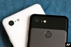 The cameras on the back of the Google Pixel 3 XL, left, and Google Pixel 3 smartphones are shown in this photo, in New York, Wednesday, Oct. 10, 2018. (AP Photo/Richard Drew)