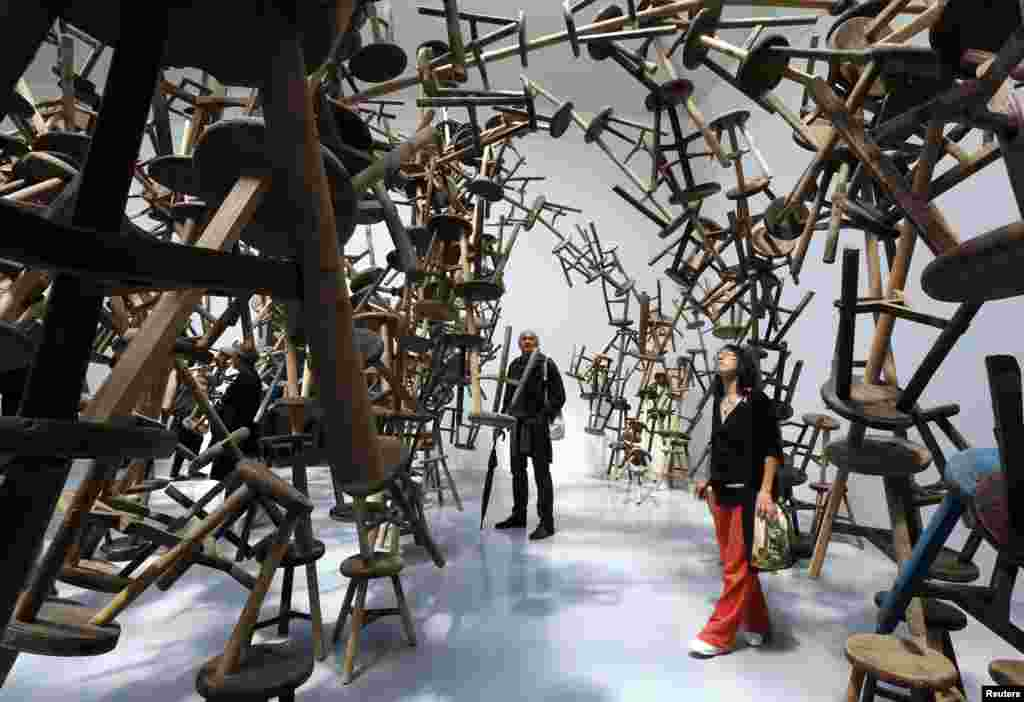 "Visitors looks at the installation called "" Bang "" by China's artist Ai Weiwei at the German pavilion during the 55th La Biennale of Venice, May 29, 2013."