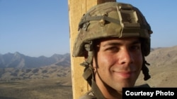 Sergeant Devin Burgett of Iowa City, Iowa, who served in Afghanistan from 2010 to 2011, says he would back a candidate who supports staying in Afghanistan to try to help the Afghan people.
