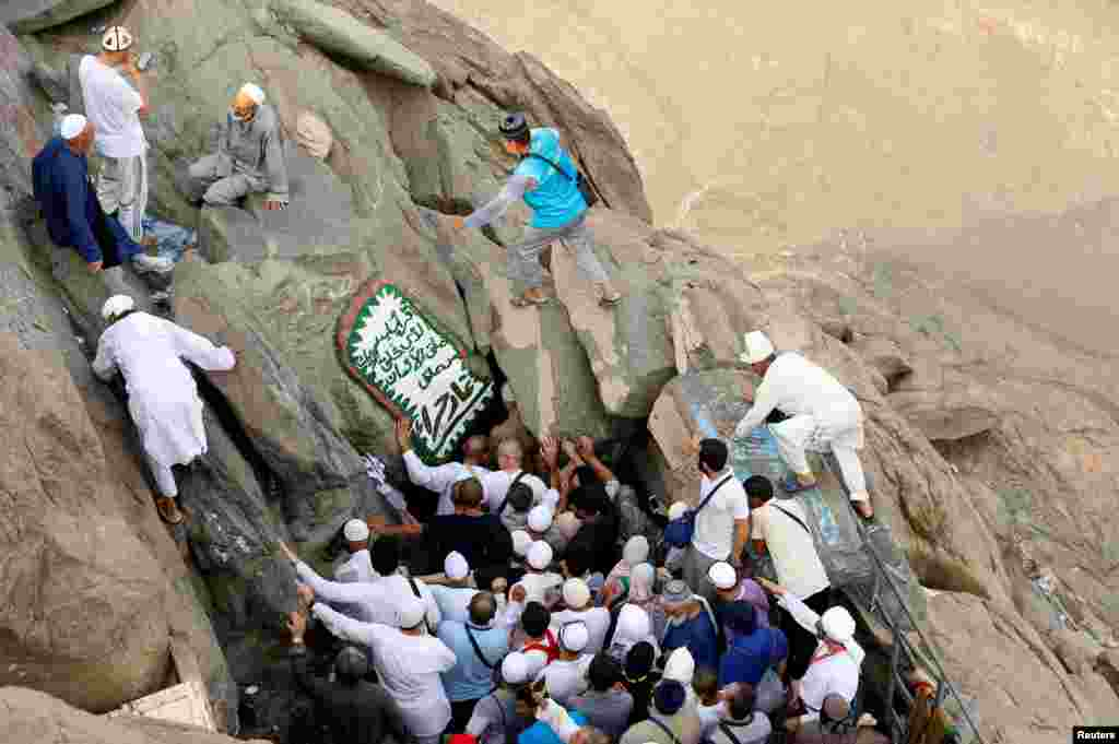 Muslim pilgrims visit the Hera cave, where Prophet Mohammad was believed to receive the first words of the Quran through Gabriel, at the top of Mount Al-Noor, ahead of the annual haj pilgrimage in the holy city of Mecca, Saudi Arabia, Sept. 7, 2016.