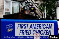 Federal Bureau of Investigation personnel search an address during an investigation into Ahmad Khan Rahami, who was wanted for questioning in an explosion in New York, which authorities believe is linked to the explosive devices found in New Jersey, Sept. 19, 2016.