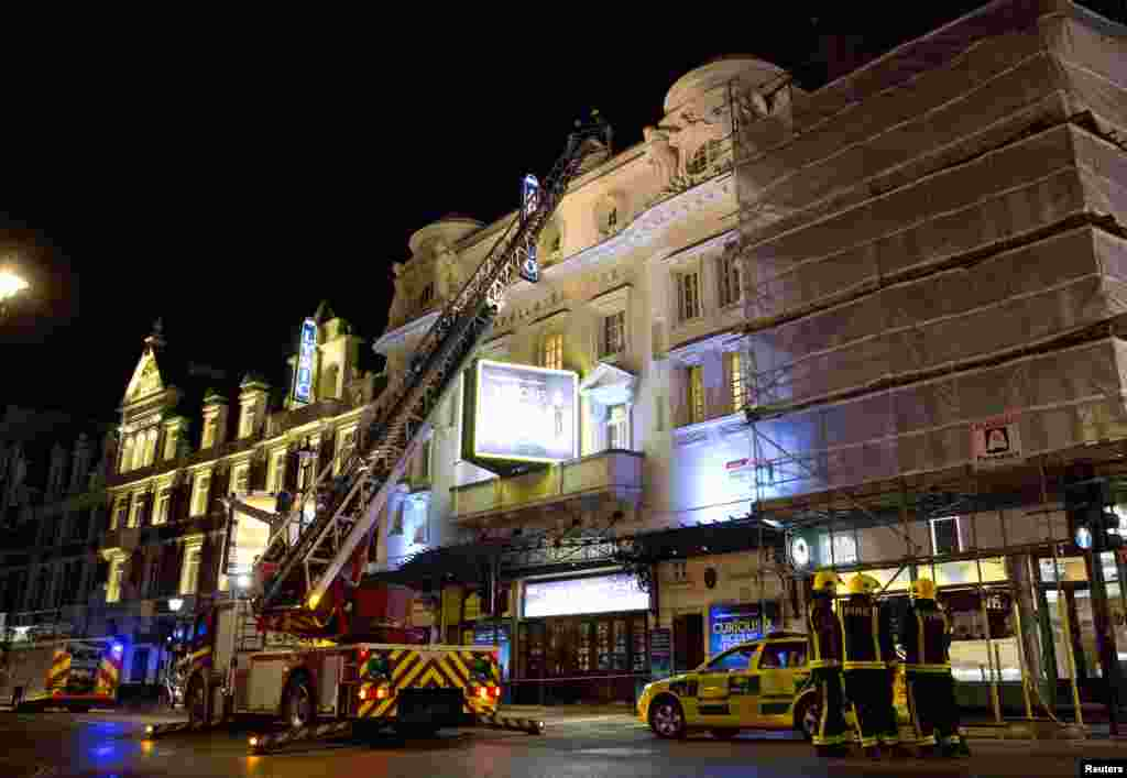 Emergency services look at the roof of the Apollo Theatre after part of the ceiling collapsed, Shaftesbury Avenue, London, Dec. 19, 2013.