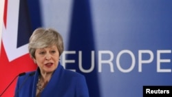 FILE - British Prime Minister Theresa May holds a news conference following an extraordinary European Union leaders summit to discuss Brexit, in Brussels, Belgium April 11, 2019.