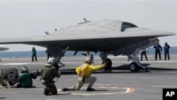 US Navy X-47B drone is launched off aircraft carrier USS George H. W. Bush off the coast of Virginia, May 14, 2013