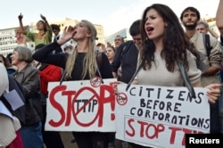 FILE - Thousands of people demonstrate against the Transatlantic Trade and Investment Partnership (TTIP) and the EU-Canada Comprehensive Economic and Trade Agreement (CETA) in the center of Brussels, Belgium, Sept. 20, 2016.