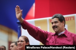 Venezuela's President Nicolas Maduro waves as he arrives for a rally with supporters in Caracas, Venezuela, Nov. 7, 2017.