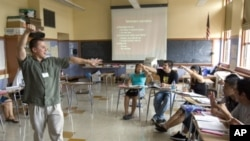 ESL (English-as-a-second-language) teacher Xavier Chavez teaches a summer history class at Benson High School in Portland, Oregon in this file photo.