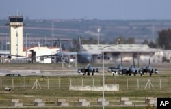 Saudi jet fighters are shown parked at Incirlik Air Base in southern Turkey, Feb. 26, 2016.