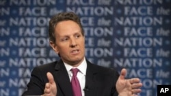 "In this photo provided by CBS News, U.S. Treasury Secretary Timothy Geithner talks about the debt crisis on CBS's ""Face the Nation"" in Washington, July 10, 2011"