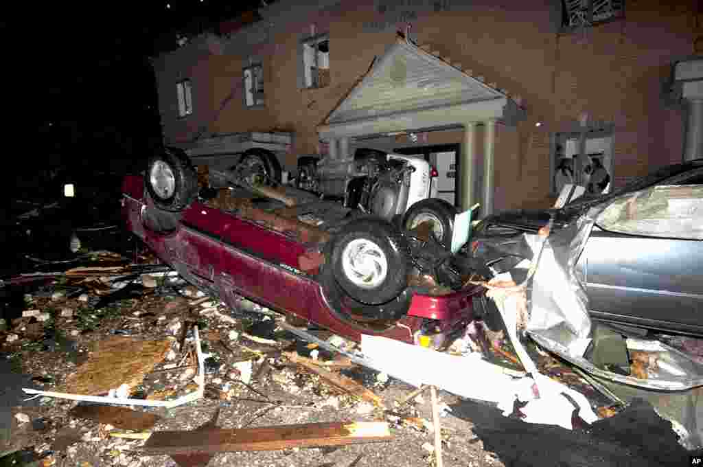 Vehicles, including two police cruisers, are piled up in front of the West Liberty City Hall following a tornado strike, in West Liberty, Kentucky. It was the second tornado to hit the town in a week. (APl)