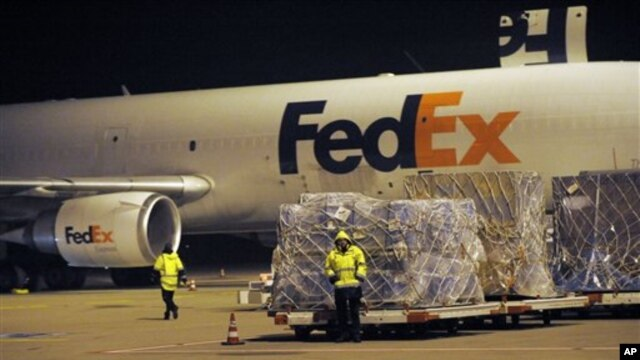 A cargo plane is loaded at the FedEx distribution center at the International Cargo Airport in Cologne, western Germany, 01 Nov 2010