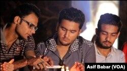 کراچی میں سانحہ لاہورکے متاثرین سے یکجہتی، شمعیں روشن کی گئیں